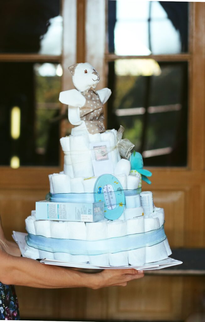 Diaper raffle for a baby shower. This adorable diaper cake is an adorable idea for expectant moms
