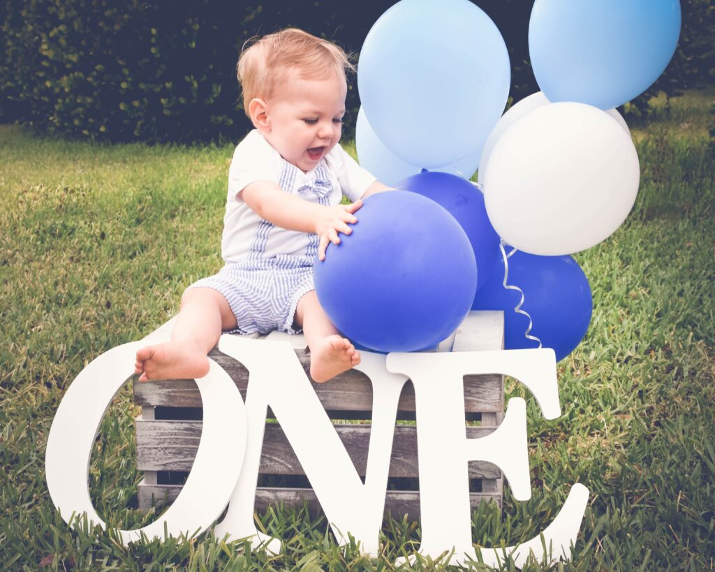 first birthday baby boy with balloons