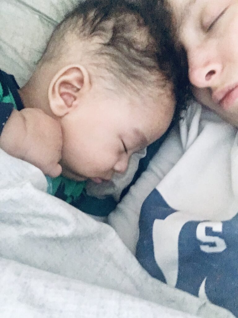 Adorable baby co sleeping with mom