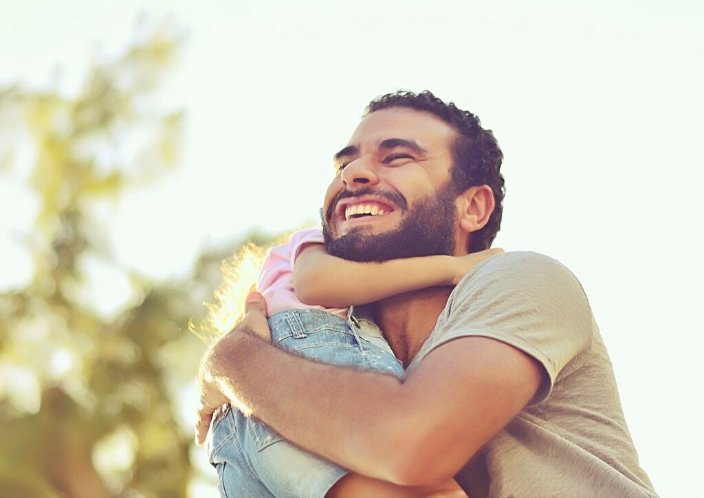 Dad hugging his daughter - good fathers are men who WANT to be dads