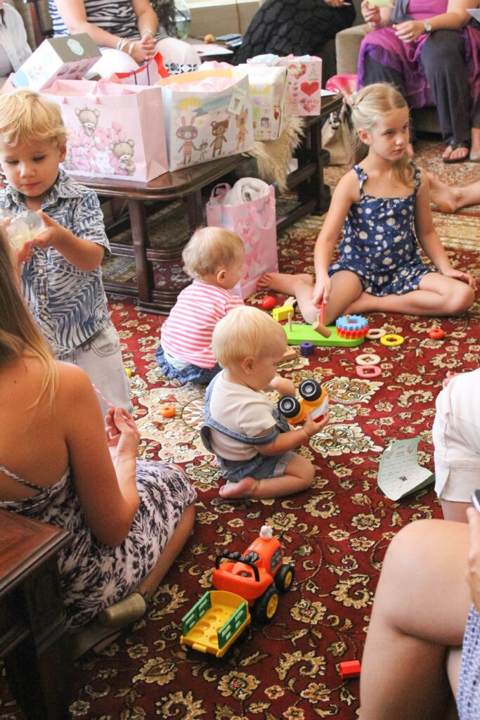 Kids playing at a baby sprinkle