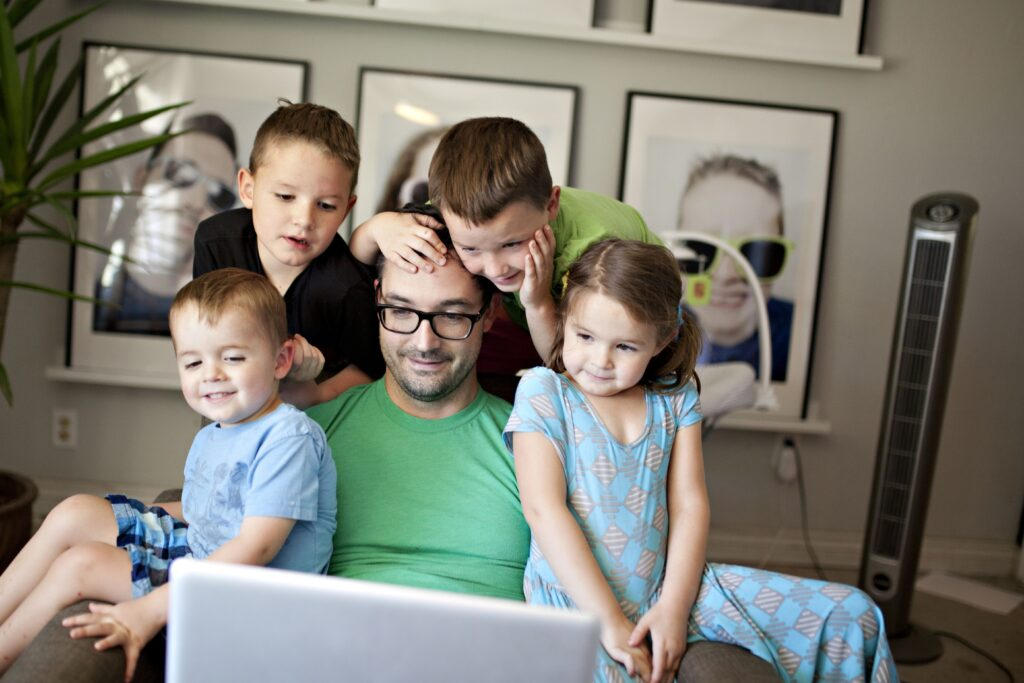Work from home dad with his four children - men who are willing to learn tend to make great dads