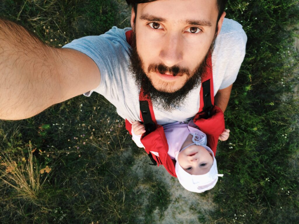Goofy Men make the best dads! Father taking a selfie with his son