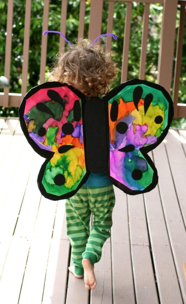 DIY Butterfly wings are the perfect craft idea for 2 year olds. They will absolute love this summer craft!